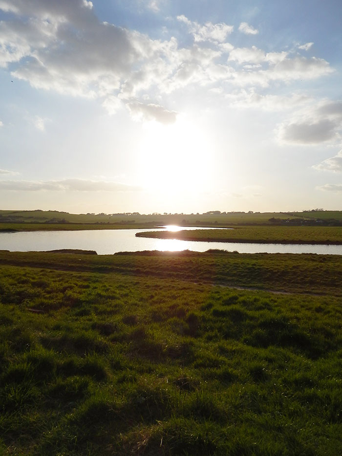 river reflection water sun set seven sisters country park england dover uk